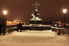 Night View on snowy Sculpture of Jesus from Prague Charles Bridge, Czech Republic Stock Image