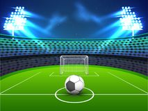 Night view of a soccer ground with flud lights, goal net and soc Royalty Free Stock Photo
