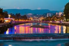 Night view of Sochi river and Malyy Kubanskiy bridge. Night view of illuminated Malyy Kubanskiy bridge, Sochinskiy bridge and Sochi river with lights reflected Royalty Free Stock Image