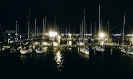 Night view of some leisure yachts moored at a dock in Lakeview