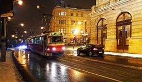 A night view of the speedy red tram rail transportation in prague. City stock photos