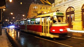 A night view of the speedy red tram rail transportation in prague. City stock image