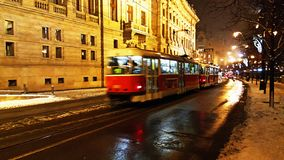 A night view of the speedy red tram rail transportation in prague. City stock photo