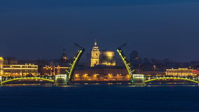 Night view of spit of opened Birzhevoy Bridge timelapse, Saint Petersburg, Russia. Night view of opened Birzhevoy Bridge withTserkov' svyatoy velikomuchenitsy stock video