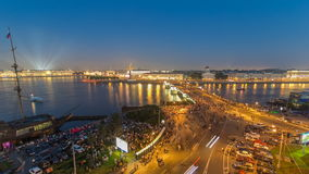 Night view of spit of Vasilyevsky Island and Birzhevoy Bridge with rostral column timelapse, Saint Petersburg, Russia. stock video footage