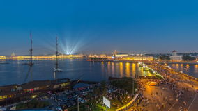Night view of spit of Vasilyevsky Island and Birzhevoy Bridge with rostral column timelapse, Saint Petersburg, Russia. stock footage