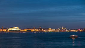Night view of spit of Vasilyevsky Island and opened Birzhevoy Bridge with rostral column timelapse, Saint Petersburg. Night view of spit of Vasilyevsky Island stock video footage
