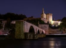 Night view of St. Benezet Bridge with Palace of Pope in Avignon , France Rhone river in foreground royalty free stock photo