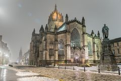 St. Giles` Cathedral in Edinburgh on a Freezing Foggy Night. Night View of St. Giles` Cathedral and Royal Mile Shrouded in Fog in Edinburgh Old Town Royalty Free Stock Image