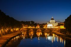 Night view of St. Peter`s Basilica. Ponte Sant Angelo and Tiber River in Rome - Italy. Dramatic sunset with sbeautiful. Water reflection. Italy postcard Stock Image