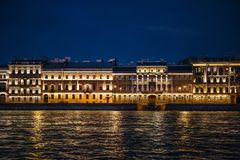 Night View of St. Petersburg from Neva River, buildings on embankment with. Light reflection in water Stock Photo