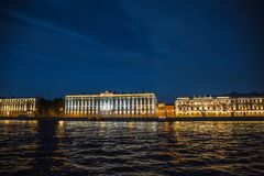 Night View of St. Petersburg from Neva River, buildings on embankment. With light reflection in water Stock Photography