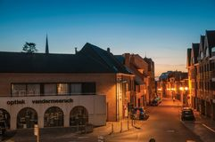 Night view of street with houses at dusk in Tielt. Tielt, Belgium - July 02, 2017. Night view of street with houses at dusk in Tielt. Charming and quiet village Stock Photos