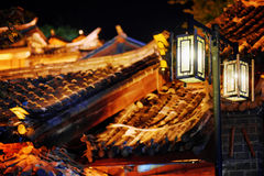 Night view of street lamp and traditional Chinese roofs Royalty Free Stock Images