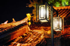 Night view of street lamps and traditional Chinese tile roofs Royalty Free Stock Images