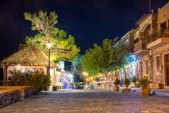 Night view of a street with night life, cafe and restaurants in Plaka village, at the gulf of Elounda, Greece. Night view of a street with night life, cafe and Stock Photos