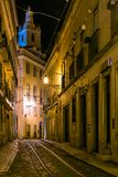 Night view of a street in Lisbon. Night view of a narrow street in Lisbon, with tram tracks through the Alfama neighborhood Stock Photography