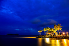 Night view of sunset bar at tropical beach. Royalty Free Stock Photo