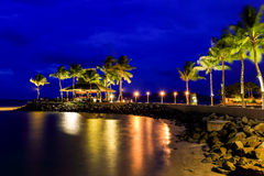 Night view of sunset bar at tropical beach. Royalty Free Stock Photography
