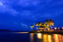 Night view of sunset bar at tropical beach. Royalty Free Stock Photos
