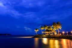 Night view of sunset bar at tropical beach. Royalty Free Stock Photos