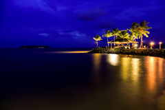 Night view of sunset bar at tropical beach. Royalty Free Stock Images
