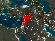 Night view of Syria. Country of Syria in red on planet Earth with clouds at night. 3D illustration. Elements of this image furnished by NASA Stock Image