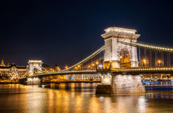 Night view of the Szechenyi Chain Bridge in the Bupapest, Hungary. Night view of the Szechenyi Chain Bridge is a suspension bridge that spans the River Danube Stock Image