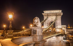 Night view of the Szechenyi Chain Bridge in the Bupapest, Hungary. Night view of the Szechenyi Chain Bridge is a suspension bridge that spans the River Danube Royalty Free Stock Photo