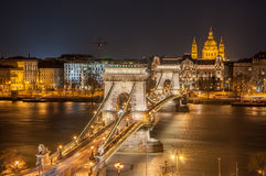 Night View of the Szechenyi Chain Bridge and church St. Stephen's in Budapest. Night View of the Szechenyi Chain Bridge over Danube River and church St. Stephen' Stock Photography