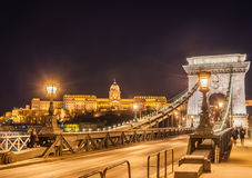 Night view of the Szechenyi Chain Bridge over Danube River and Royal Palace in Budapest. Night view of the Szechenyi Chain Bridge over Danube River and Royal Stock Image