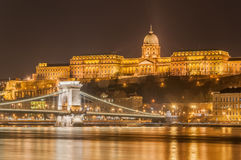 Night view of the Szechenyi Chain Bridge over Danube River and Royal Palace in Budapest, Royalty Free Stock Photography