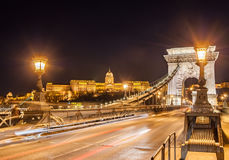 Night view of the Szechenyi Chain Bridge over Danube River and Royal Palace in Budapest Royalty Free Stock Photos