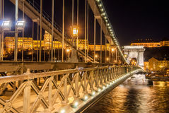 Night view of the Szechenyi Chain Bridge on the River Danube in Budapest. Night view of the Szechenyi Chain Bridge is a suspension bridge that spans the River Royalty Free Stock Photography