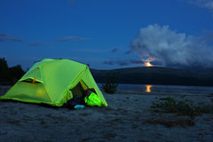 Night view of the tent near a mountain lake Royalty Free Stock Image