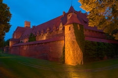 Night view of the Teutonic Order castle in Malbork, Poland. Malbork, Poland, June 23, 2015: Night view of the medieval Castle of the Teutonic Order in Malbork ( Royalty Free Stock Image