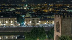 Night view timelapse of the Gate of Saint Nicholas, Synagogue, Arno river and other palaces from Piazzale Michelangelo. Florence, Italy. Evening illumination stock video