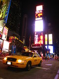 Night view of Times Square. Yellow taxi in front of the neon signs of Times Square at night in New York Royalty Free Stock Photos