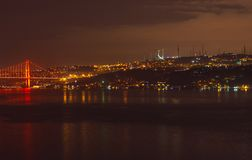 Night view to Bosphorus bridge and Camlica Cami. Istanbul, Turkey stock photos
