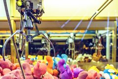 Night view to claw machine full of colorful soft toys. Lights glowing on glass. Ayia Napa, Cyprus Stock Photo