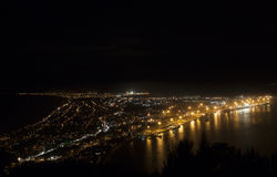 Night view to Mount Maunganui beach and city. Night view from the top of Mount Maunganui to the beach and suburbia Royalty Free Stock Photos