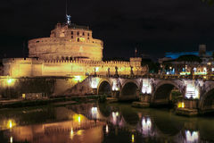 Night view to Saint Angel Castle and bridge under river Tiber at night in Rome, Italy. Panoramic view of Bridge at night overlooking the Tiber river, and Angel Stock Photography