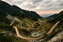 Night view of Romanian Transfagarasan Highway serpentine, car light trails stock images
