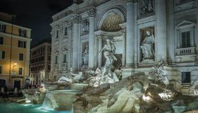 The Trevi Fountain. Night view of the Trevi Fountain, the largest baroque fountain in Rome, Italy. It is a popular tourist destination for millions of people Stock Images