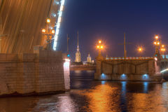 Night view of Trinity Bridge and Peter and Paul Cathedral. Night view of illuminated Neva River, open Trinity Bridge and Peter and Paul Cathedral between its Royalty Free Stock Photos
