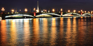 Night view of the Troitsky Bridge in St.Petersburg. Night view of the Troitsky Bridge with illumination in St.Petersburg, Russia Stock Photography