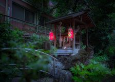 Night view of the Tsunokami Benzaiten shrine at the Mouchi no Ik. Night view of the Tsunokami Benzaiten shrine at the Mouchi ni Ike sacred shinto shrine Stock Photo