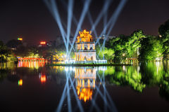 Night view of the Turtle Tower among blue light rays, Hanoi Stock Photo