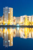 Night View Of Urban Residential Area Near City Lake Or River And Park Royalty Free Stock Photography