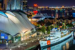 Night view of the USCGC Taney at the Inner Harbor in Baltimore, Maryland stock image